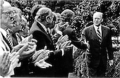 United States President Gerald R. Ford shakes hands in the White House Rose Garden in Washington, D.C. on September 2, 1974 after an outdoor signing of the Pension Reform Bill.<br /> Mandatory Credit: David Hume Kennerly / White House via CNP