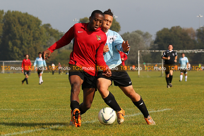 Tottenham Phoenix (red/black) vs Shakespeare - Hackney & Leyton Sunday League Football at South Marsh, Hackney Marshes, London - 28/09/14 - MANDATORY CREDIT: Gavin Ellis/TGSPHOTO - Self billing applies where appropriate - 0845 094 6026 - contact@tgsphoto.co.uk - NO UNPAID USE