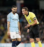 Manchester City's Ilkay Gundogan and referee Andreas Ekberg<br /> <br /> Photographer Rich Linley/CameraSport<br /> <br /> UEFA Champions League Group F - Manchester City v TSG 1899 Hoffenheim - Wednesday 12th December 2018 - The Etihad - Manchester<br />  <br /> World Copyright © 2018 CameraSport. All rights reserved. 43 Linden Ave. Countesthorpe. Leicester. England. LE8 5PG - Tel: +44 (0) 116 277 4147 - admin@camerasport.com - www.camerasport.com