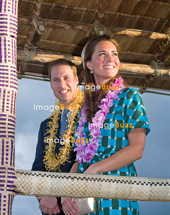 CATHERINE, DUCHESS OF CAMBRIDGE AND PRINCE WILLIAM.received a traditional welcome on arrival at Honiara Airport at the start of thei 2 day visit to the Solomon Islands..After the arrival ceremony where they were presented with garlands the Royal Couple board a float in the shape of a fishing vessel for the drive to the local church for Sunday Mass. Large crowds of locals lined the route to caych a glimpse of the Kate and Prince William_16/09/2012.