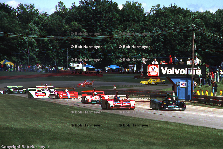 Fastest qualifier Bobby Rahal, driving the Prophet 2/Chevrolet (black, right side of frame), leads the field to the green flag for the Can-Am race on June 8, 1980 at the Mid-Ohio Sports Car Course near Lexington, Ohio. Patrick Tambay, second fastest qualifier, starts alongside in the Lola T530 HU2/Chevrolet.