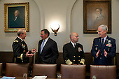 General Martin Dempsey, Chairman of the Joint Chiefs of Staff, left, talks with United States Secretary of Defense Leon Panetta as Admiral James G. Stavridis talks with General Douglas M. Fraser, right,  before a meeting of Combatant Commanders and senior military leadership in the Cabinet Room of the White House in Washington, D.C. on May 15, 2012. .Mandatory Credit: Pete Souza - White House via CNP