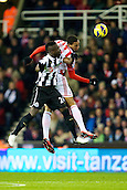 28.11.2012. Stoke, England.  Newcastle United's Ivory Coast midfielder Cheick Tioté in heading duel with Nzonzi during the Premier League game between Stoke City and Newcastle United from the Britannia Stadium, Stoke.