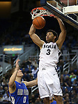 Nevada's AJ West slam dunks over Air Force defender Marek Olesinski during an NCAA basketball game in Reno, Nev., on Saturday, Feb. 1, 2014. Nevada won 69-56 in overtime. (AP Photo/Cathleen Allison)