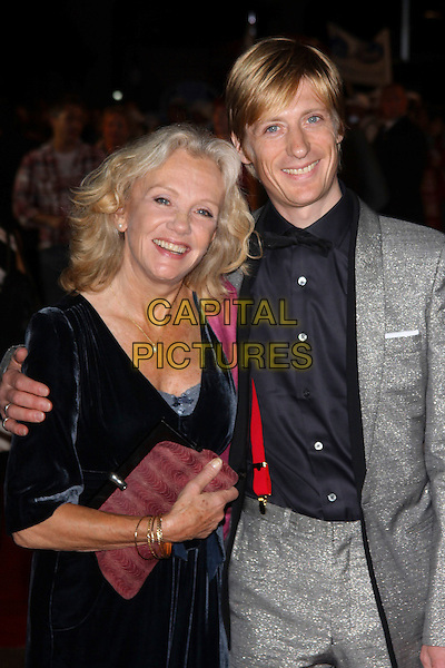 "HAYLEY & CRISPIAN MILLS.""Made In Dagenham"" UK film premiere held at the Odeon Leicester Square,  London, England, 20th September 2010..half length grey gray suit black blue velvet dress arm around family mother mum son mom .CAP/AH.©Adam Houghton/Capital Pictures."