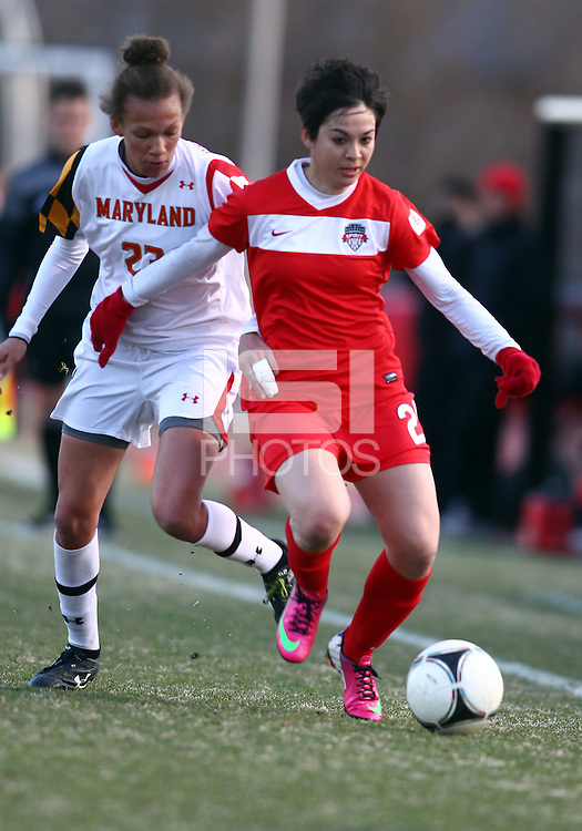 COLLEGE PARK, MARYLAND - April 03, 2013:  Diana Weigel (24) of The Washington Spirit gets away from Alexis Prior-Brown (23) of the University of Maryland women's soccer team in a NWSL (National Women's Soccer League) pre season exhibition game at Ludwig Field in College Park Maryland on April 03. Maryland won 2-0.