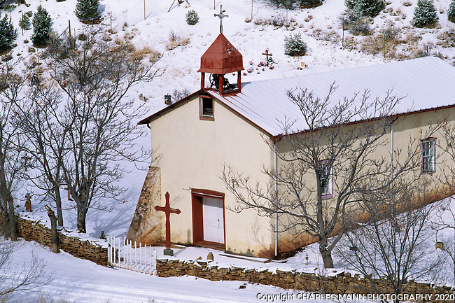 A coating of winter snow graces a small church at Apache Canyon near Santa Fe, New MExico