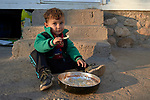 A Yazidi boy eats a meal in a camp for internally displaced persons at Dawodiya in Iraq's Kurdistan region. More than 600 families living in the camp escaped from their communities in the Sinjar region during the attempted genocide by the Islamic State group. Although ISIS was militarily defeated in 2017, these Yazidi families say it's still not safe to return home, nor do they have sufficient resources to rebuild their homes.<br /> <br /> The Lutheran World Federation, a member of the ACT Alliance, provides water, sanitation, garbage collection, and psycho-social support for the families in the camp.