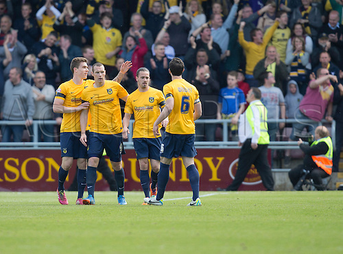 03.05.2014.  Northampton, England.  Oxford players celebrate their goal during the FA League 2 match between Northampton Town and Oxford United at Sixfields Stadium.