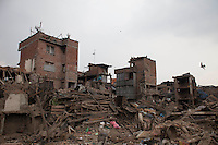 People work near collapsed houses following the earthquake in Bhaktapur, near Kathmandu, Nepal. May 7, 2015