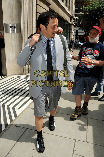 ROB SCHNEIDER.Leaving BBC Radio 2, London, England..July 1st, 2010.full length grey gray suit jacket shorts black tie socks trainers sneakers hand profile.CAP/IA.©Ian Allis/Capital Pictures.