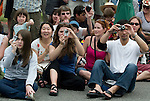 Photographers take pictures of bicycle riders in the 21st annual Summer Solstice Parade held Saturday, June 20, 2009 in Seattle, Wa. The parade was held Saturday, bringing out painted and naked bicyclists, bands, belly dancers and floats. (Jim Bryant Photo © 2009)