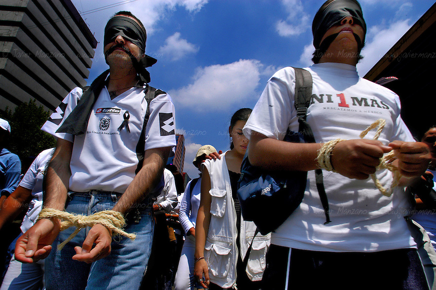 On June 27, 2004, thousands of concerned citizens, victims of crime and a unified Mexico marched through Reforma, one of Mexico City's main roads towards the main Square (Zocalo) in downtown Mexico City. The reason? A growing wave of organized crime has plagued the city and the country as a whole, affecting every aspect of daily life. A country under siege, a country paralyzed by its own inability to fight it's own socio-economic ills. ..Mexico City. 06/27/04.