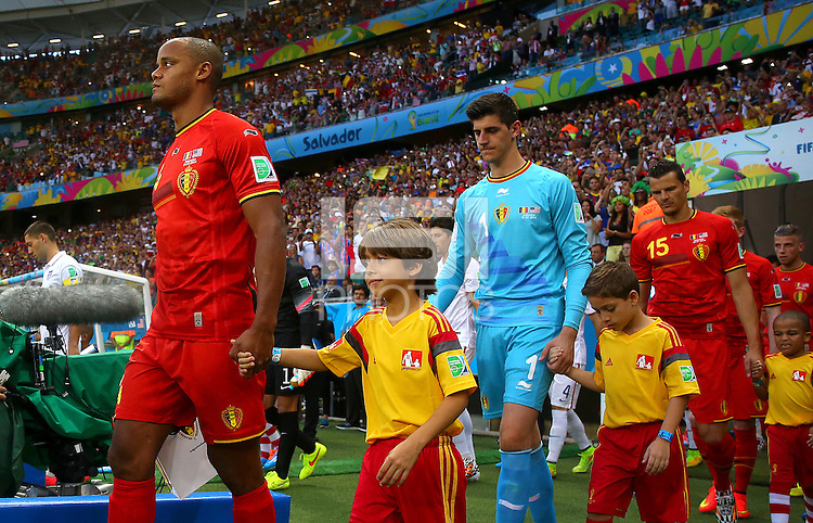 Vincent Kompany of Belgium leads his side out before kick off
