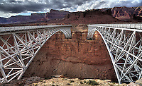 The old and new Navajo Bridges span the Colorado River at Lees Ferry Arizona
