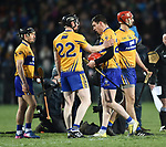 A clearly disappointed Niall Deasy returns to his team mates after missing a vital free, and is consoled by Jamie Shanahan, during their NHL quarter final free taking shootout against Limerick at the Gaelic Grounds. Photograph by John Kelly.