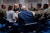 United States President Donald J. Trump, third left, and First Lady Melania Trump, center, listen while speaking to Marines with John Kelly, White House chief of staff, front center, at Marine Barracks in Washington, D.C., U.S, on Thursday, Nov. 15, 2018. President Trump and the First Lady are meeting with Marines who responded to a building fire at the Arthur Capper Public Housing complex on September 9, 2018. <br /> Credit: Andrew Harrer / Pool via CNP