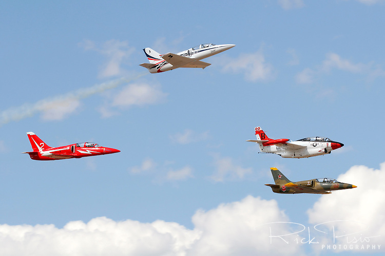 Air Race Pilot Rick Vandam pulls his L-39 Albatross towards the heavens as John Penney, Albatross Race 2, Rich Sugden, T2-B Buckeye Race 00, and Phil Fogg, Albatross Race 8 maintain the missing man formation in honor of fellow race pilot Brad Morehouse who was killed in a racing accident at the Annual Reno National Championship Air Races in Nevada on September 13, 2007. Photographed at Stead Field in Nevada, site of the Reno Air Races, on 9/16/07