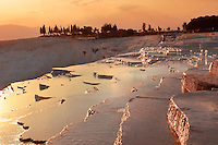 Photo & Image  of Pamukkale Travetine Terrace, Turkey, at sunset. Images of the white Calcium carbonate rock formations. Buy as stock photos or as photo art prints. 4 Pamukkale travetine terrace water cascades, composed of white Calcium carbonate rock formations, Pamukkale, Anatolia, Turkey