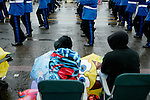 People try to stay dry during a parade Saturday, June 9 2007, during the Rose Festival in Portland, Ore. The event spotlight the riches of the Pacific Northwest heritage and environment while offering colorful examples of many international cultures.  (Chad Pilster)