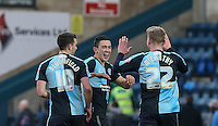 Jason McCarthy of Wycombe Wanderers & Jason McCarthy of Wycombe Wanderers celebrate with Luke O'Nien (centre) of Wycombe Wanderers at the final whistle during the Sky Bet League 2 match between Wycombe Wanderers and Bristol Rovers at Adams Park, High Wycombe, England on 27 February 2016. Photo by Andrew Rowland.