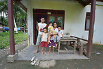 Ferianus Laia and his family in Tugala, a village on the Indonesian island of Nias. Ferianus, 9, is in the red shorts. His father is Atonira Laia, his mother Damaria Halawa. His sister is Elviana, 4, and his brother Albeanus is 6.<br /> <br /> The village was struck by both a 2004 tsunami and a 2005 earthquake, leaving houses destroyed and lives disrupted. The ACT Alliance helped villagers here to construct new homes and latrines, build a potable water system, open a clinic and schools and get their lives going once again. For the residents of Tugala, the post-disaster mantra of &quot;build back better&quot; became a reality with help from the ACT Alliance.