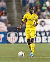 Columbus Crew midfielder Tony Tchani (6) looks to pass. In a Major League Soccer (MLS) match, the New England Revolution tied the Columbus Crew, 0-0, at Gillette Stadium on June 16, 2012.