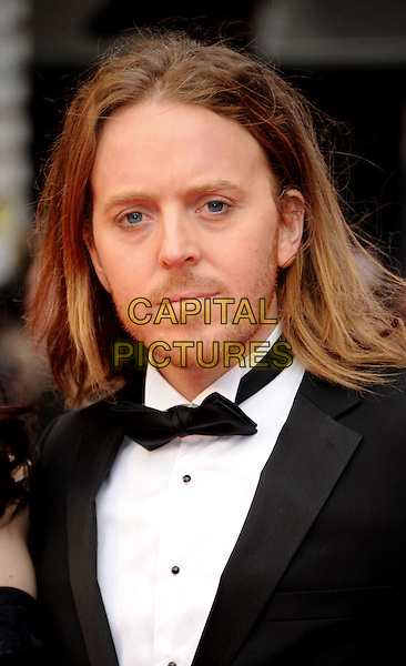 Tim Minchin.The Olivier Awards 2012, Royal Opera House, Covent Garden, London, England..April 15th, 2012.headshot portrait black white bow tie stubble facial hair.CAP/WIZ.© Wizard/Capital Pictures.