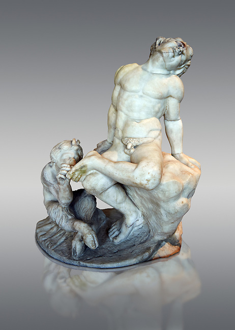 Pan removing a thorn from the foot of a satyr. 1st - 2nd AD Roman sculpture in marble. Pan (Faunus to the Romans) , the Greek god of shepherds, is recognisable as a hybrid of half-man half-goat. This group, of which several Roman versions exist, dates from circa 50 BC. The Borghese Collection inv MR 193 ( or Ma 320 ), Louvre Museum Paris