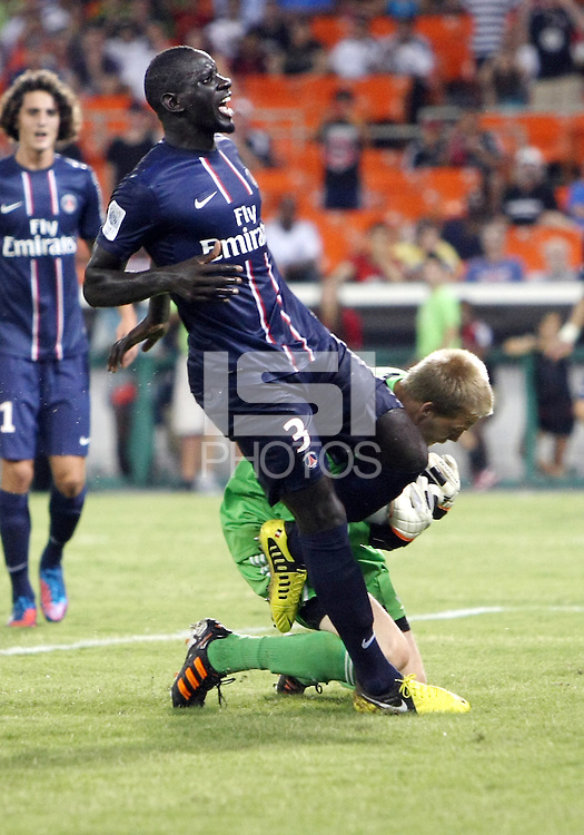 WASHINGTON, DC - July 28, 2012:  Joe Willis (31) of DC United saves from Mamadou Sakho (3) of PSG (Paris Saint-Germain) in an international friendly match at RFK Stadium in Washington DC on July 28. The game ended in a 1-1 tie.