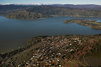 aerial photograph Soda Bay with the Buckingham peninsula in the middleground right and Glenhaven and the snow covered mountains in the background, Lake County, California