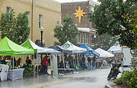 NWA Democrat-Gazette/BEN GOFF @NWABENGOFF<br /> People run for cover Friday, June 7, 2019, during a brief downpour at First Friday on the Bentonville square. This month the theme was 'Living Local' with a focus on local history, food, music and businesses.