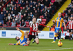Danny Lafferty of Sheffield Utd in brought down by Jim O'Brien of Shrewsbury during the English League One match at the Bramall Lane Stadium, Sheffield. Picture date: November 19th, 2016. Pic Simon Bellis/Sportimage