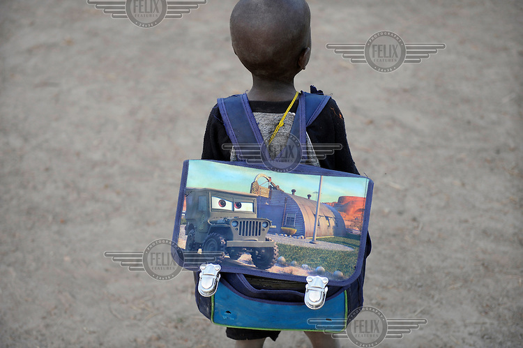 A child on his way to school in the village of Siramana.