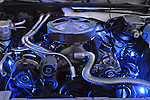 Bellmore, New York, USA. 7th August 2015. Closeup of engine air filter, hoses, and more lit by blue lights under open hood of white 1987 Chevy Monte Carlo, owned by John Gilson, of Islip, at the Friday Night Car Show held at the Bellmore Long Island Railroad Station Parking Lot. Gilson was one of many members of the South Side Boys auto club attending the Cruise Night. Hundreds of classic, antique, and custom cars were on view at the free weekly show, sponsored by the Chamber of Commerce of the Bellmores.