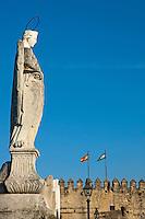 Calahorra Tower behind the statue of San Rafael the patron saint of Cordoba, Andalusia, Spain.