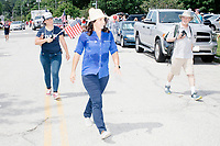 Democratic presidential candidate and Hawaii representative (D-HI 2nd) Tulsi Gabbard marches in the 4th of July Parade in Amherst, New Hampshire, on Thu., July 4, 2019.