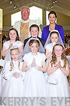 Pupils from Meenkilly NS who received their 1st holy communion, pictured here last Saturday was f l-r: Alana McGrath, Shauna Finn, Aoife Broderick. B l-r: Amy Stack, Jack O'Connell and Tammy O'Sullivan, also pictured was  Fr O'Shea and Mrs Gleeson in the Church of The Assumption, Abbeyfeale.