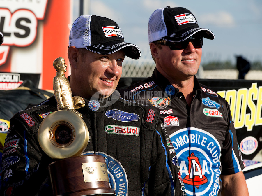 Sept. 2, 2013; Clermont, IN, USA: NHRA funny car driver Robert Hight (left) celebrates with crew chief Mike Neff after winning the US Nationals at Lucas Oil Raceway. Mandatory Credit: Mark J. Rebilas-