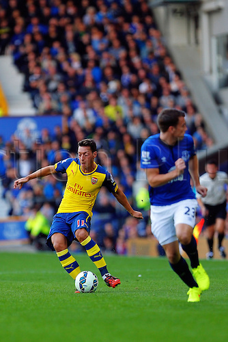23.08.2014.  Liverpool, England. Premier League. Everton versus Arsenal. Arsenal midfielder Mesut Ozil passes the ball