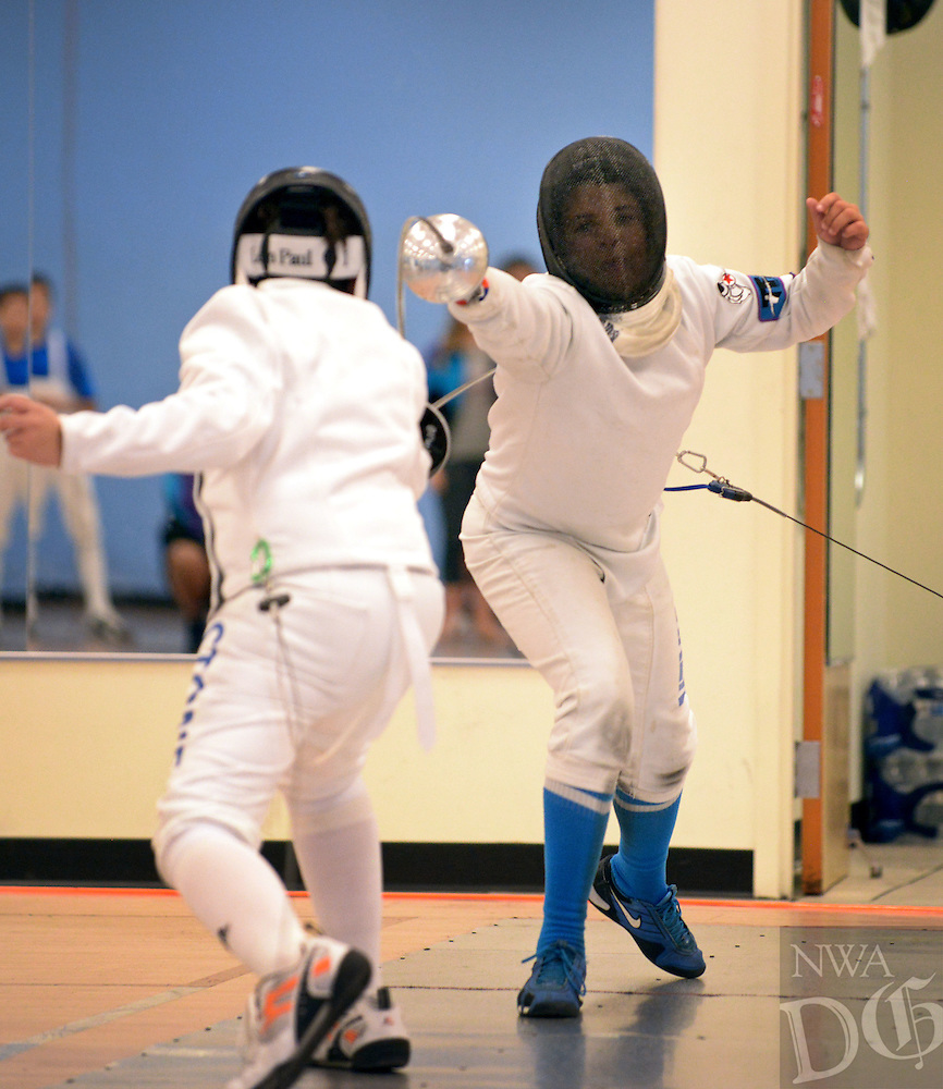 NWA Democrat-Gazette/BEN GOFF @NWABENGOFF<br /> Riley Parker (right), 11, from Texas Fencing Academy in Austin, scores the final touch to defeat Henry Stone, 12, of Oklahoma Sport Fencing in Mustang, Okla. in the final bout to win the Y12 epee event on Sunday Oct. 18, 2015 during the 3 Swords Regional Youth Circuit fencing tournament at Northwest Arkansas Fencing Center in Bentonville. The three-day tournament was part of a qualifying path to youth Summer Nationals next year in Salt Lake City, Utah, and proceeds benefitted the Northwest Arkansas Fencing Foundation, the non-profit wing of the Northwest Arkansas Fencing Center dedicated to helping under-served and at-risk youth age 6-18 through the sport of fencing.