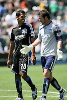 Ramon Sanchez (20) and Joe Cannon (1) walk off the field together during half time. The San Jose Earthquakes defeated Seattle Sounders FC 4-0 at Buck Shaw Stadium in Santa Clara, California on August 2, 2009.