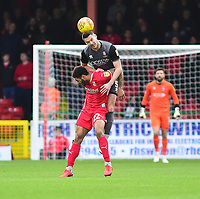 Lincoln City's Jason Shackell gets above Swindon Town's Kaiyne Woolery to head clear<br /> <br /> Photographer Andrew Vaughan/CameraSport<br /> <br /> The EFL Sky Bet League Two - Swindon Town v Lincoln City - Saturday 12th January 2019 - County Ground - Swindon<br /> <br /> World Copyright © 2019 CameraSport. All rights reserved. 43 Linden Ave. Countesthorpe. Leicester. England. LE8 5PG - Tel: +44 (0) 116 277 4147 - admin@camerasport.com - www.camerasport.com