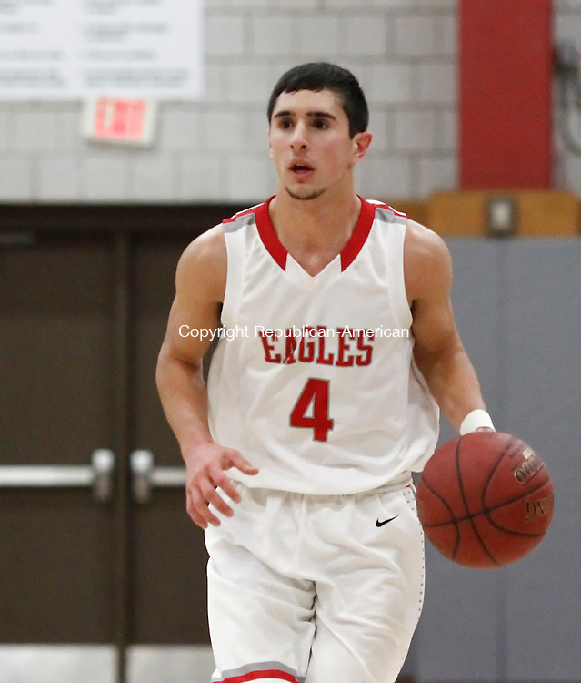 Wolcott, CT- 10 January 2015-011015CM07- action man----  Wolcott's Vin Gambino brings the ball up court during their basketball matchup against New Milford in Wolcott on Saturday.    Christopher Massa Republican-American