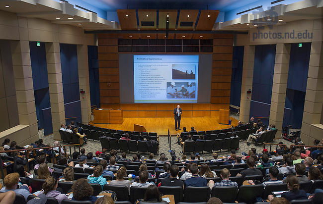 """Oct. 3, 2014; Wayne Murdy, retired chairman & former CEO of Newmont Mining Corporation, speaks in Jordan Auditorium as part of the Mendoza College of Business """"Boardroom Insights"""" lecture series. (Photo by Barbara Johnston/University of Notre Dame)"""