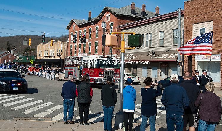 THOMASTON,  CT--- -041616JS04--Parents and supporters lined the streets of Thomaston on Saturday for the annual Thomaston Little League opening day parade from Seth Thomas Park to Reeves Field. <br /> Jim Shannon Republican-American