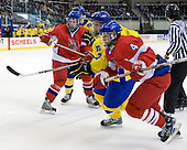 ?, Gabriel Landeskog (Sweden - 14), Oldrich Horak (Czech Republic - 4) - Sweden defeated the Czech Republic 4-2 at the Urban Plains Center in Fargo, North Dakota, on Saturday, April 18, 2009, in their final match of the 2009 World Under 18 Championship.