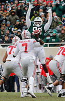 Michigan State Spartans defensive tackle Raequan Williams (99) leaps in front of Ohio State Buckeyes quarterback Dwayne Haskins Jr. (7) during the second quarter of the NCAA football game at Spartan Stadium in East Lansing, Mich. on Nov. 10, 2018. [Adam Cairns/Dispatch]