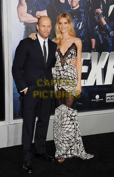 HOLLYWOOD, CA- AUGUST 11: Actor Jason Statham (L) and actress/model Rosie Huntington-Whiteley arrive at the Los Angeles premiere of 'The Expendables 3' at TCL Chinese Theatre on August 11, 2014 in Hollywood, California.<br /> CAP/ROT/TM<br /> &copy;Tony Michaels/Roth Stock/Capital Pictures