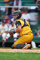 Jacksonville Suns catcher Sharif Othman (6) checks the runner during the 20th Annual Rickwood Classic Game against the Birmingham Barons on May 27, 2015 at Rickwood Field in Birmingham, Alabama.  Jacksonville defeated Birmingham by the score of 8-2 at the countries oldest ballpark, Rickwood opened in 1910 and has been most notably the home of the Birmingham Barons of the Southern League and Birmingham Black Barons of the Negro League.  (Mike Janes/Four Seam Images)